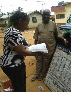 Mrs. Teresa R. Kemp with historian and tour guide Paul Amuah in Bonwire Ghana. Documenting the UGRR Quilt Code symbols and comparing the meanings with Kente languages and Adinkra symbols.
