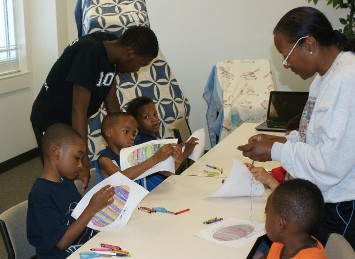 Youth quilting, sewing classes, ages 4-8, St. Phillip's Summer Camp, Ms. Teresa Kemp instructing boys quilting class, Atlanta GA