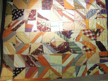 Mary Eva McDaniel Farrow's Crazy Quilt made with recycled clothes from family member's out grown clothes.