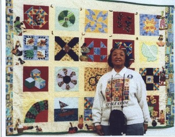 Serena Strother Wilson in front of quilt she made to teach the UGRR Secret Quilt Code, her families legacy. She was the 4th generation quilter of the Farrow McDaniel's family.
