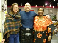 Teresa R. Kemp with guest of the Irish Festival at the UGRR Quilt Museum Exhibit. Plaid is also a textile language.