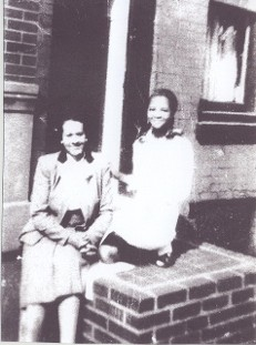 Mrs/ Sarah (Green-Strother) Quattlebaum & her sister Serena Strother on the stoop in Philadelphia, PA. Sarah worked sewing for the Singer Sewing Company and polished Serena's Sewing skills and sent her to Catholic School.