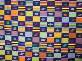 Kente Fabric with dreidles and menorah shapes in the strips of woven Kente. This is one of the textiles with the Language of Kente Exhibit that came to the UGRR Secret Quilt Code Exhibit in Atlanta, GA