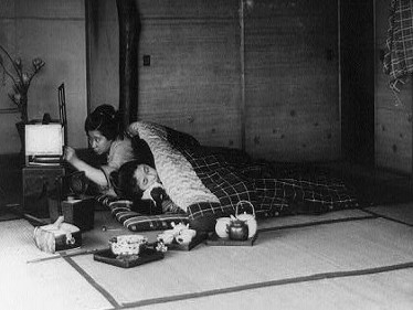 Japanese women quilt and used it to keep warn. Here they are under a quilt in their beds made in their community. They drank hot tea to warm them on the inside. The tea pot and cups are in this photo by their bed.