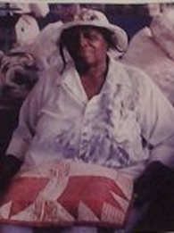 My Great aunt Ozella McDaniel Williams with her quilts in the Charleston market where our family has sold quilts, sweet grass basket, hand made jewelry  & lemonade for over 50 years.